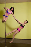 Two women in the pole dance studio Stock Images