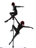 Two women pole dancer silhouette Stock Photo