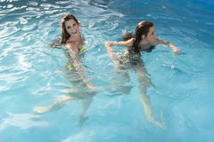 Two women in the pool Stock Photos