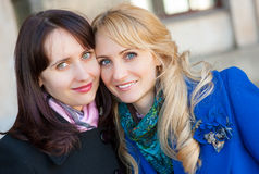 Two women portrait outdoors Stock Images