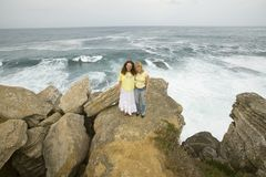 Two women pose at Cruz do Remedios, near Peniche, west coast of Portugal Royalty Free Stock Photo
