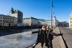 Two women posing in front of the canals of Gothenburg Sweden royalty free stock image