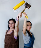Two women posing with a roller and mallet Stock Photography