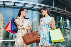 Two women posing with shopping bugs in front of the shopping center Stock Photo