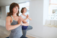 Two women practice yoga together Stock Photo