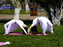 Two women practicing yoga Royalty Free Stock Images
