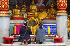Two - women - prayers - Thailand; stock photography