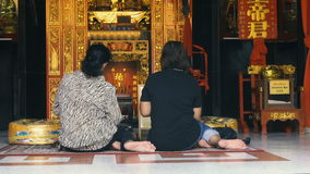 Two Women Praying in Chinese Temple stock video