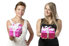 Two women with presents Stock Images