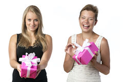 Two women with presents Stock Photo