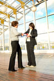 Two women pulling documents Royalty Free Stock Photos