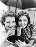 Two women putting on makeup Stock Photo