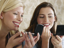 Two Women Putting On Makeup Royalty Free Stock Image