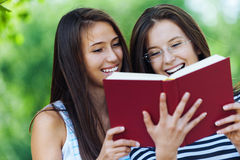 Two women read red book Royalty Free Stock Photos
