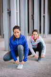 Two women ready for running. Two female athletes ready for urban running. Women getting ready for fitness workout and exercising Royalty Free Stock Image