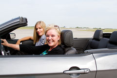 Two women ready to drive convertible Stock Photos