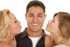 Two women ready to kiss man close big smile Stock Photo