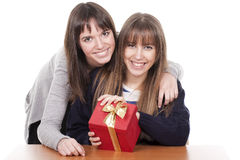 Two women with a red box Royalty Free Stock Photo