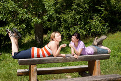 Two women relax in nature Stock Photos