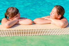 Two women relax at the   pool Stock Photo