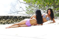 Two women relaxing on beach Royalty Free Stock Photography
