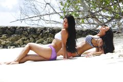 Two women relaxing on beach royalty free stock image
