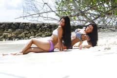Two women relaxing on beach Stock Images
