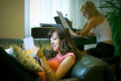 Two women relaxing at home Stock Images