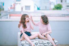 Two women relaxing on rooftop Royalty Free Stock Photography