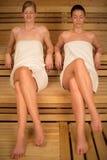 Two women relaxing in sauna stock photography
