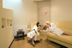 Two women at resort spa stock photo