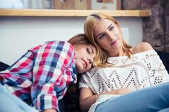 Two women resting on the sofe royalty free stock images