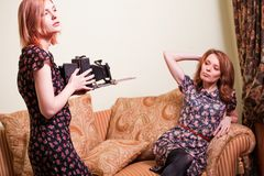 Two women with retro camera Royalty Free Stock Photo