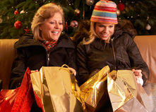 Two Women Returning After Christmas Shopping Trip Stock Photo