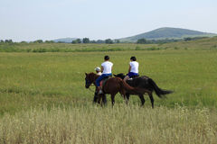 Two women riding horses Royalty Free Stock Image