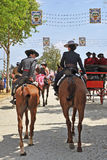 Two women riding in the Seville Fair, Andalusia, Spain Stock Photos