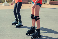Two women rollerblading Stock Photos