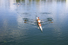 Two Women Rower in a boat Stock Image