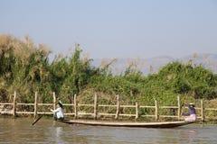 Women Rowing Canoe. Two women rowing a dugout canoe in Inle Lake, Myanmar Royalty Free Stock Photos