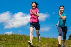 Two women running. Active family - mother with daughter running Stock Photography