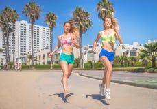 Two women running Stock Photography