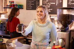 Two Women Running Coffee Shop Together Royalty Free Stock Image