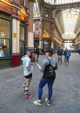 Two women in running outfit stand and talk in london leadenhall Royalty Free Stock Images