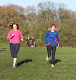 Two women running Royalty Free Stock Images