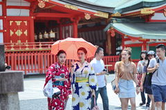 Two women`s kimonos enjoy to respect ,Fushimi Inari shrine. Royalty Free Stock Photo