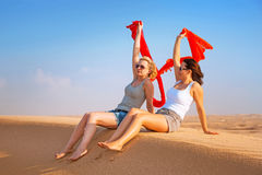 Two women in the sandy desert Royalty Free Stock Photography