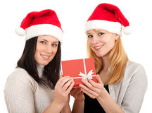 Two women in Santa hat keeping red box Stock Photography