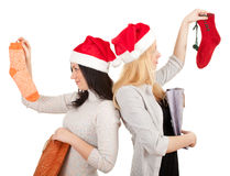 Two women in Santa hats with present bags Royalty Free Stock Images