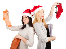 Two women in Santa hats with present bags Royalty Free Stock Photography