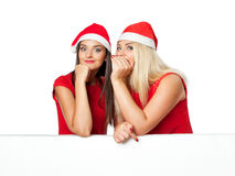 Two women in santa helper hat with blank white board Stock Photography
